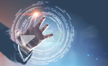 Hand of an unrecognizable man with a glowing finger interacting with HUD interface. Blurred gray background. Toned image double exposure