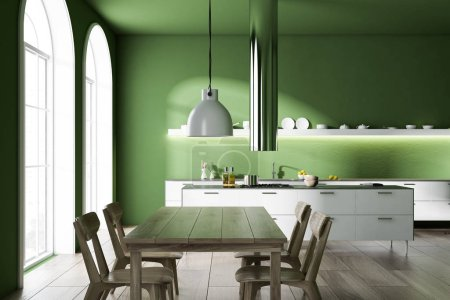 Photo for Modern kitchen interior with green walls, a wooden floor, arched windows and white countertops. A long table with chairs. 3d rendering mock up - Royalty Free Image