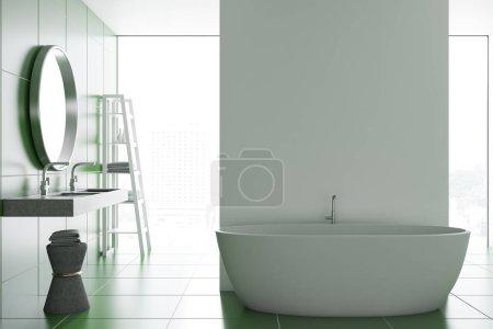 Photo pour Vue de face d'un intérieur de salle de bains carrelage blanc et vert avec une belle baignoire blanche, une double vasque et un miroir rond. rendu 3D maquette - image libre de droit
