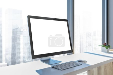 Side view of a mock up computer screen standing on a white table of a freelance designer or programmer. 3d rendering mock up