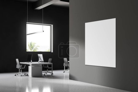 Corner of Industrial style office with gray walls, a white glossy floor and computer table. Blank vertical poster on the wall. Business and finance. 3d rendering mock up