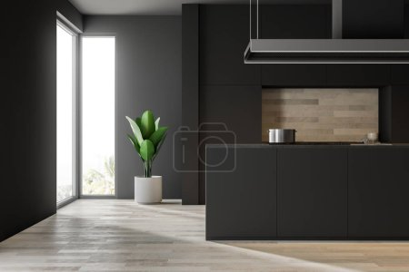 Photo for Black wall kitchen interior with a wooden floor, black closets and countertops and an island with a sink. Loft windows. 3d rendering mock up - Royalty Free Image