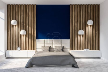 Photo for Minimalistic bedroom interior with blue and wooden walls, a white wooden floor and a double bed with two bedside tables and stylish ceiling lamps. 3d rendering copy space - Royalty Free Image