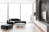 Side view of loft living room with wooden floor and black wooden walls, a sofa and a round coffee table. Flat screen TV set. 3d rendering mock up