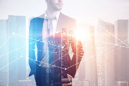 Photo for Unrecognizable bearded businessman looking sideways standing with hands in pockets over a cityscape with graphs in the foreground. Toned image double exposure copy space - Royalty Free Image