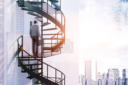 African American businessman climbing a spiral ladder of a skyscraper. Cityscape background. Career ladder concept. Toned image double exposure copy space blurred