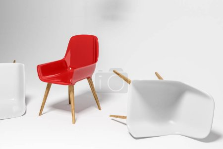 White chairs lying on white room floor. Red chair still standing. Concept of being unique and strong in life and business. 3d rendering copy space