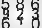 Vertical rows of big black numbers over white background. Concept of math, arithmetics and economy. 3d rendering