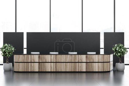 Photo pour Table de réception en bois avec des ordinateurs permanent dans la compagnie noire avec baie vitrée. espace de copie de rendu 3D - image libre de droit