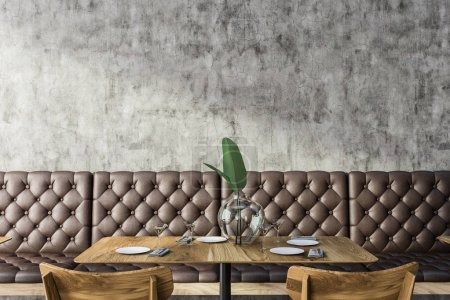 Photo for Grunge restaurant interior with concrete wall, square wooden table and chairs and leather sofa. 3d rendering mock up - Royalty Free Image