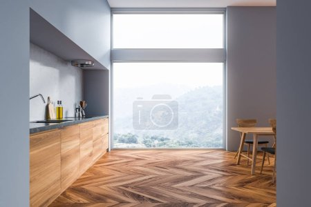 Photo for Interior of modern kitchen with gray walls, wooden floor, gray and wooden countertops, a table with chairs and loft window. 3d rendering - Royalty Free Image