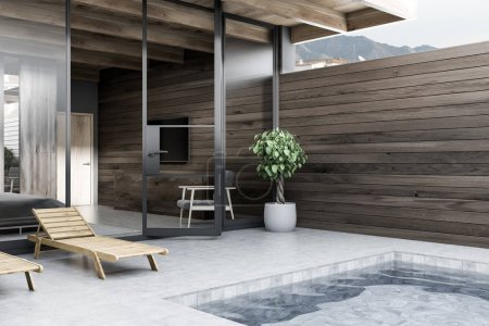 Two deck chairs standing near private pool. Master bedroom with gray bed in the background. Dark wooden walls. Luxury lifestyle concept. 3d rendering
