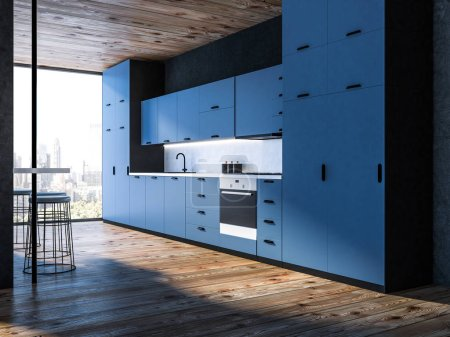Interior of modern kitchen with black walls, wooden floor, blue countertops, and loft window. 3d rendering