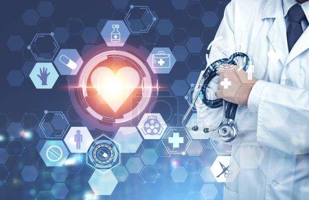 Photo pour Homme méconnaissable médecin tenant un stéthoscope. Icônes cardiaques et médicales au premier plan. Image tonique double exposition - image libre de droit
