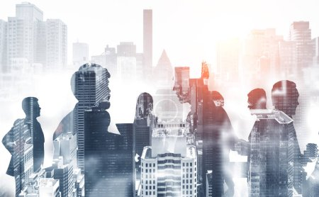 Photo for Silhouettes of business people communicating over gray cityscape background. Corporate lifestyle concept. Toned image double exposure - Royalty Free Image