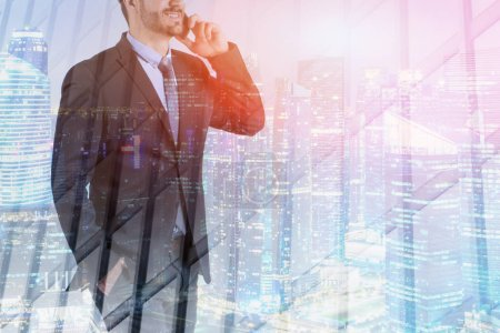 Photo for Unrecognizable bearded businessman talking on smartphone and smiling standing over night cityscape background. Toned image double exposure - Royalty Free Image