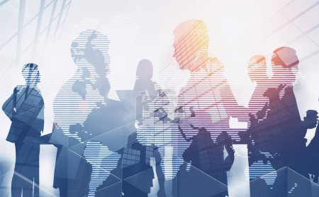 Photo for Silhouettes of business people discussing work over skyscraper background with double exposure of world map. Toned image. Elements of this image furnished by NASA - Royalty Free Image