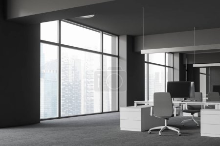 Photo for Corner of open space office with gray walls and floor, large windows and white computer tables with gray chairs. 3d rendering - Royalty Free Image