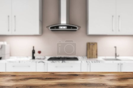 Photo for White kitchen countertops with built in cooker and sink and white cupboards above them located in kitchen with beige walls. Wooden table in the foreground. 3d rendering blurred - Royalty Free Image