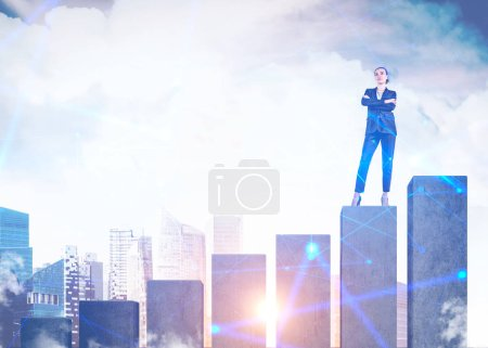 Photo for Confident young businesswoman standing with crossed arms on giant graph over cityscape background with double exposure of network interface. Concept of leadership. Toned image - Royalty Free Image