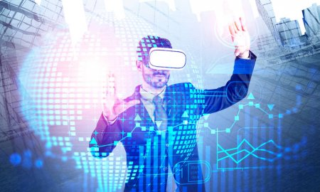 Photo for Bearded young businessman in VR glasses working with global business infographics interface in city. Concept of market analysis and fintech. Toned image double exposure - Royalty Free Image