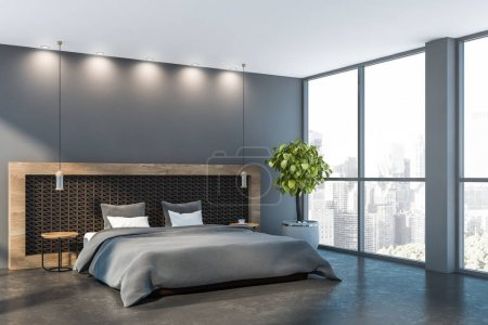 Interior of minimalistic master bedroom with gray ...