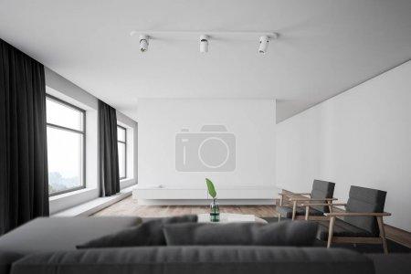 Photo pour Intérieur du salon élégant avec murs blancs, sol en bois, canapé gris avec oreillers et deux fauteuils près de la table basse ronde. Rendu 3d - image libre de droit