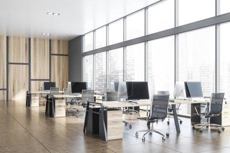 Photo for Interior of stylish open space office with gray and wooden walls, tiled floor, panoramic windows with cityscape and rows of gray and wooden computer desks. 3d rendering - Royalty Free Image