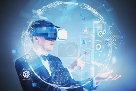Photo for Handsome young businessman in VR glasses using global business HUD interface. Concept of hi tech and programming. Toned image double exposure - Royalty Free Image
