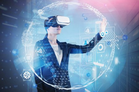 Photo for Young woman in VR glasses using global business HUD interface in server room. Concept of hi tech in business and education. Toned image double exposure - Royalty Free Image