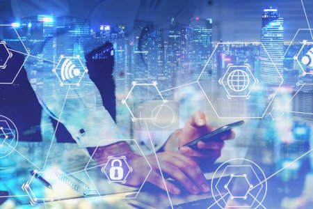 Photo for Hands of businessman working with laptop and smartphone in night city with double exposure of hi tech interface. Concept of big data and telecommunication. Toned image - Royalty Free Image