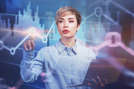 Photo for Young businesswoman with laptop working with virtual diagrams. Concept of stock market and hi tech. Toned image double exposure - Royalty Free Image