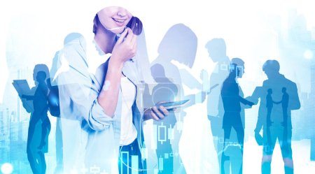 Photo for Unrecognizable businesswoman talking on smartphone in blurry abstract city with her teammates in background and double exposure of graph. Concept of communication and teamwork. Toned image - Royalty Free Image