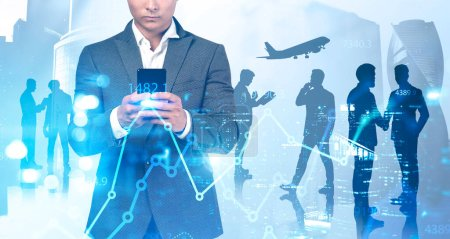 Photo for Unrecognizable young businessman using his smartphone in blurry abstract city with double exposure of digital graph and his teammates. Concept of stock market and analytics. Toned image - Royalty Free Image