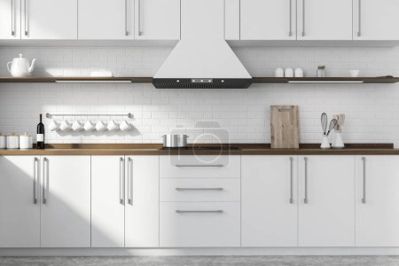 Photo for Interior of modern kitchen with white brick walls, concrete floor, white and wooden cupboards and countertops with built in sink and cooker. 3d rendering - Royalty Free Image