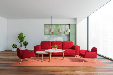 Photo for Interior of panoramic living room with white walls, red sofa and armchairs standing near round coffee tables and kitchen with green cupboards in background. Blurry cityscape. 3d rendering - Royalty Free Image