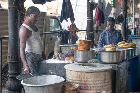 Photo for Mumbai, India - Juary 16, 2019: Men cooking indian street food - Royalty Free Image