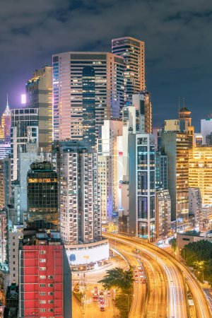 Photo for The amazing night and sunset view of cityscape and skyscrapers in Hong-Kong - Royalty Free Image