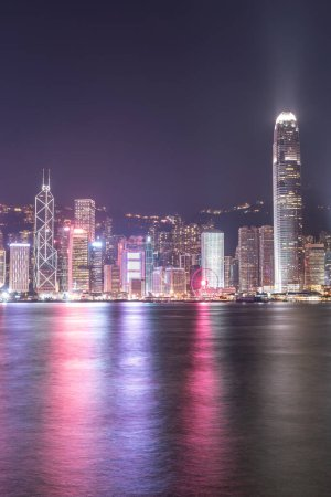 Photo for The incredible night cityscape view of lights on the water on Victoria Harbour in Hong Kong - Royalty Free Image