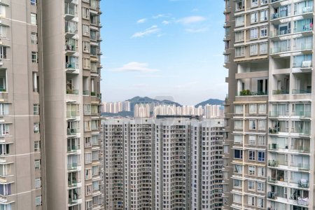 Photo for The view of residential neighborhood and skyscrapers from rooftop in Hong Kong - Royalty Free Image