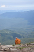 Tourist standing on Carpathian Mountains overlooking the Goverla view