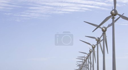 Wind generator at sea in Canary Islands under a cl...