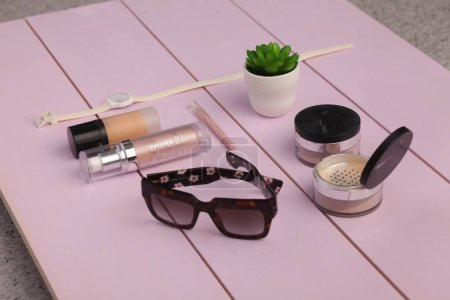 Photo for Sunglasses, cosmetics makeup and essentials on wooden background - Royalty Free Image