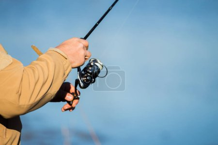 Photo for Pike fishing on the lake. Fishing recreation - Royalty Free Image