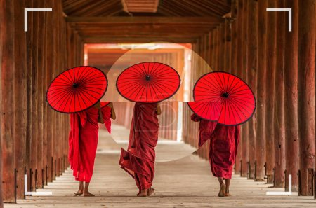camera viewfinder with focusing the screen of Back side of three Buddhist novice are walking in pagoda, Photographer with travel concept