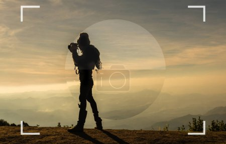 camera view finder with focusing the screen of silhouette of a photographer who shoots the mountains landscape when sunset time, Photographer concept