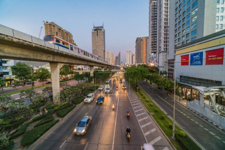 Photo for BANGKOK, THAILAND - DEC 2018 : Transportation Railroad station with traffic jam and elevated train metro system in rush hour at sunset time on December 25, 2018 in Bangkok, Thailand - Royalty Free Image