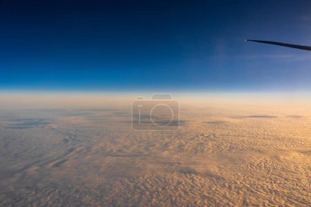 Photo for Out side above view from airplane side windows when sunrise, transportation and traveler concept - Royalty Free Image