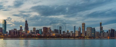 Photo for Panorama of Chicago Cityscape river side along Lake Michigan at beautiful twilight time, Illinois, United States, Business Architecture and building with tourist concept - Royalty Free Image