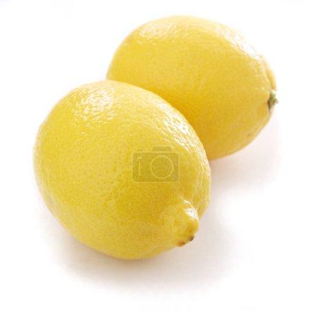 preparing fresh lemons on white background